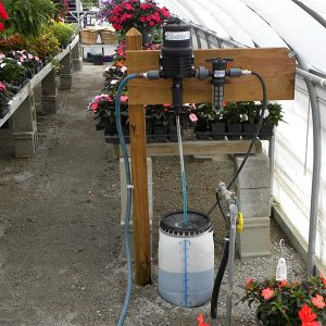 SuperDos dosing pump in a greenhouse installation